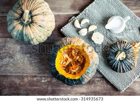 Raw pumpkin on wooden background. Healthy vegeterian cuisine ingredient closeup.  - stock photo