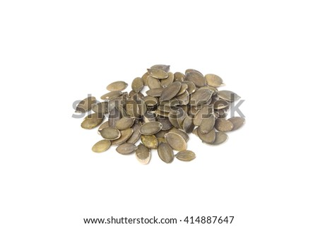 Raw pumpkin seeds, isolated on white background - stock photo