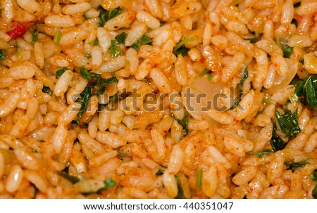 Raw rice and the other ingredients to fill vine leaves to prepare - stock photo