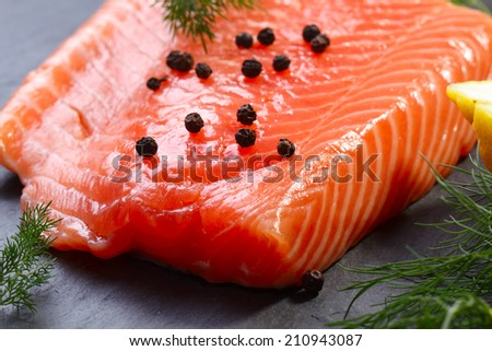 Raw salmon fillet with pepper - stock photo
