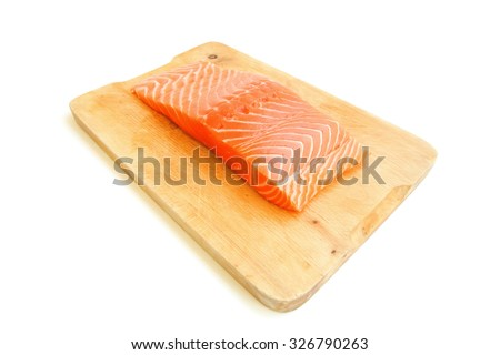 raw salmon fish piece on wooden tray isolated on white background - stock photo