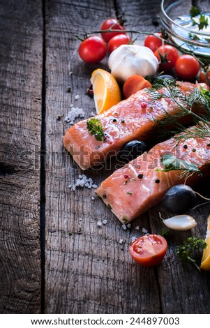 Raw salmon meat and ingredients on wooden background,selective focus  - stock photo
