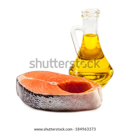 Raw Salmon Steak isolated on white with spices - stock photo