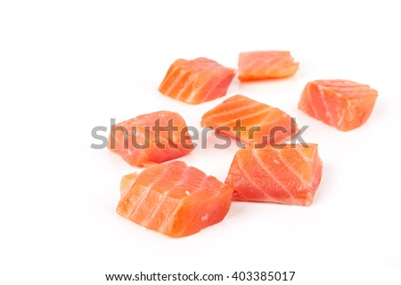 Raw salmon sushi meat cubes isolated on a white background - stock photo