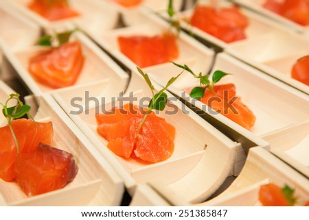 Raw salmon sushi meat cubes on  black background. - stock photo