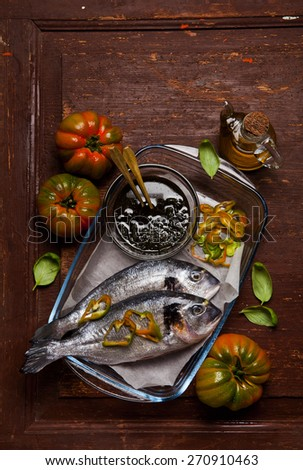 raw sea bream with homemade italian pesto ready to be put in the oven - stock photo