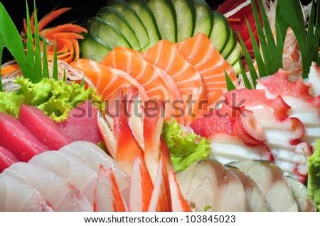 Raw seafood sashimi set crop - stock photo