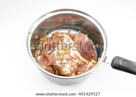 raw steak in frying pan isolated on white background - stock photo