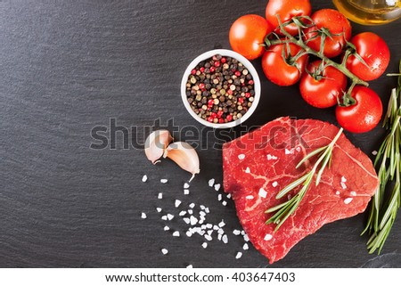 Raw steak with spices and ingredients for cooking. Top view - stock photo