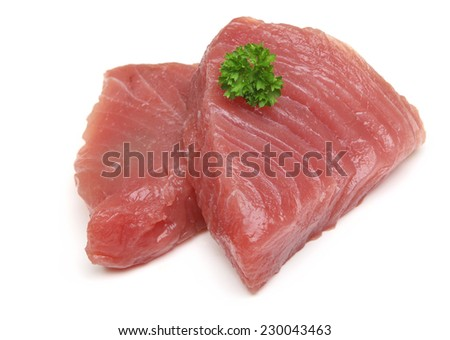 Raw tuna steaks on white background. - stock photo
