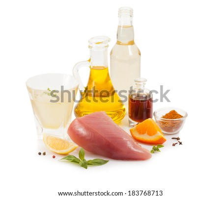 Raw turkey isolated on white with spices - stock photo