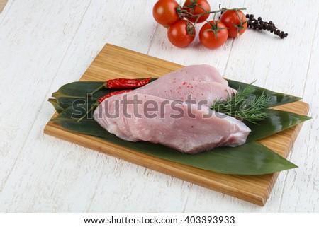 Raw turkey steak with spices ready for cooking - stock photo