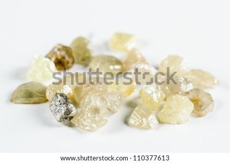 Raw, uncut and rough diamonds. - stock photo