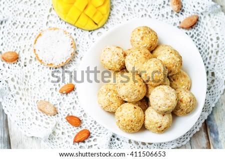raw vegan mango coconut almond balls. toning. selective focus - stock photo