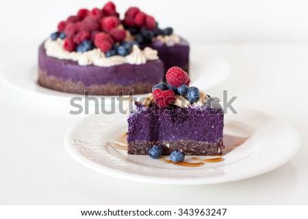 Raw vegan raspberry blueberry cheesecake - stock photo