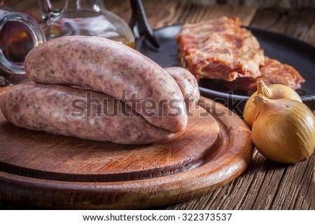 Raw white sausage - Polish culinary specialty. - stock photo