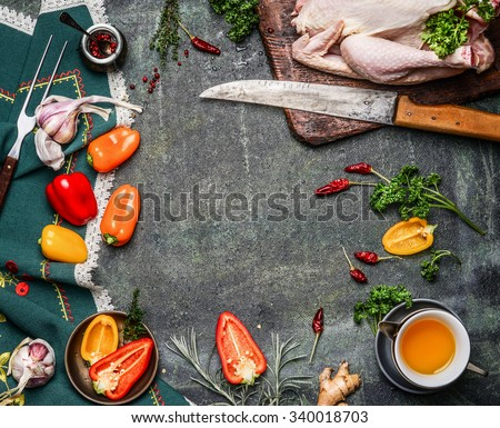 Raw whole chicken with oil and vegetables ingredients for cooking on rustic background, frame, top view.  Healthy food or diet eating concept. - stock photo