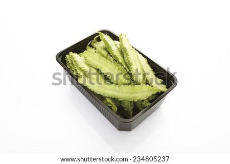 Raw winged beans (Psophocarpus tetragonolobus) in plastic container - stock photo