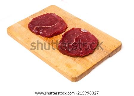 Raw Zebra steaks isolated on a white studio background, - stock photo