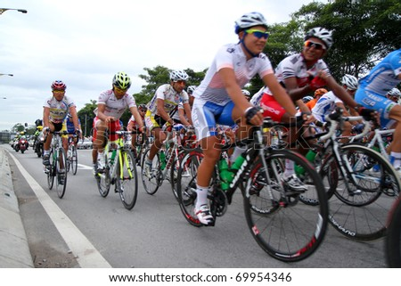RAWANG-JANUARY 28: Cyclists from various teams cycle during Stage 6 of the Tour de Langkawi from Rawang to Putrajaya on January 28 2011 in Rawang, Malaysia - stock photo