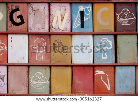 raws of used tin thin metal large rectangular cookies box painted and installed in a wall with some alphabets on the box - stock photo