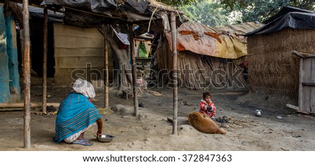 RAXAUL, INDIA - NOV 12: Unidentified Indian people on Nov 12, 2013 in Raxaul, Bihar state, India. Bihar is one of the poorest states in India. The per capita income is about 300 dollars. - stock photo