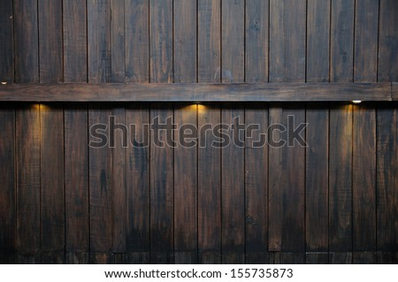 Ray lights on antique wooden wall - stock photo