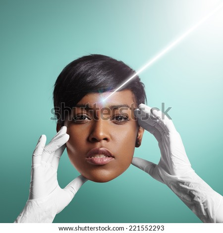 ray of laser. woman face with ideal skin in hands of a doctor - stock photo