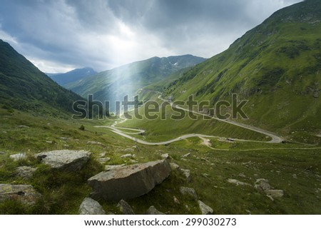Ray of light on Transfagarasan Mountain. Carpathians in Romania. Spectacular high altitude road - stock photo
