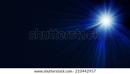 Ray of stage lighting on blue background - stock photo