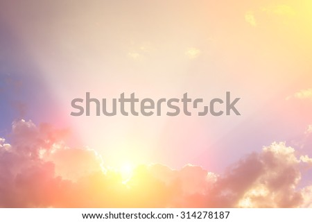 ray of sunlight on clouds with space for display text - stock photo