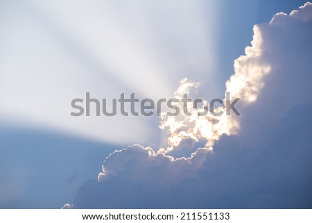 ray of sunshine between the evening clouds - stock photo