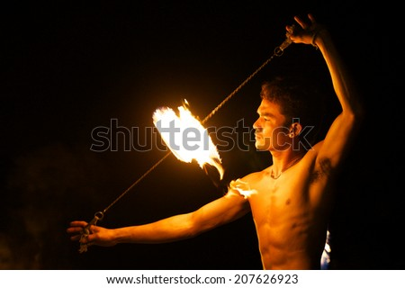 Rayong, Thailand - June, 5, 2013: amazing Fire Show on the beach at night on June, 5, 2013 at Samed Island, Rayong, Thailand. - stock photo