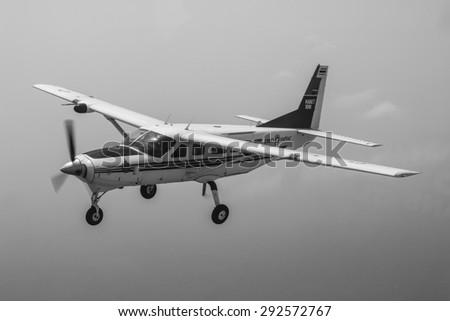 RAYONG , THAILAND- MAR 28 2015: Cessna 208 Caravan no.1918 of KASET , Bureau of Royal Rainmaking and Agricultural Aviation. U-TAPAO Airport, Rayong - stock photo