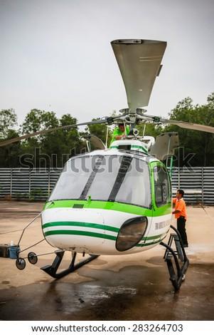 RAYONG , THAILAND- MAR 26 2015: Helicopter AS350 no.18301 of KASET , Bureau of Royal Rainmaking and Agricultural Aviation. U-TAPAO Airport, Rayong - stock photo