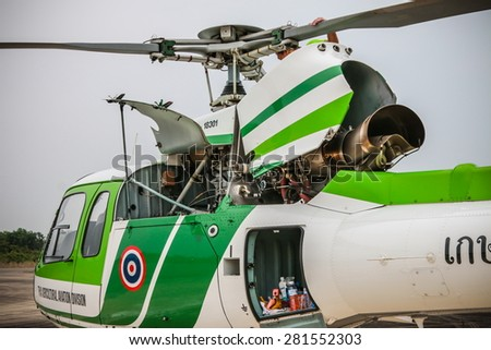 RAYONG , THAILAND- MAR 26 2015: Rotor of Helicopter AS350 no.18301 of KASET , Bureau of Royal Rainmaking and Agricultural Aviation. U-TAPAO Airport, Rayong - stock photo