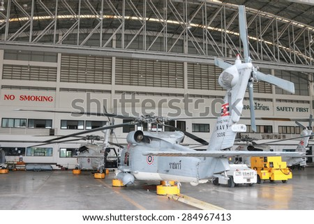 RAYONG , THAILAND- MAR 26 2015: Sikorsky UH-60 Black Hawk helicopter of royal thai navy standby in the hangar for maintenance. U-TAPAO Airport, Rayong - stock photo