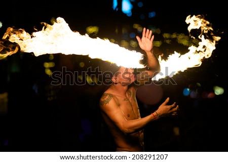 Rayong, Thailand - May, 3, 2014: amazing Fire Show on the beach at night on May, 3, 2014 at Samed Island, Rayong, Thailand. - stock photo