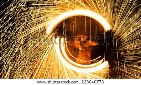 Rayong, Thailand - October, 12, 2014 : steel wool spinning in amazing fire show on the beach at night on October, 12, 2014 at Samed Island, Rayong, Thailand. - stock photo