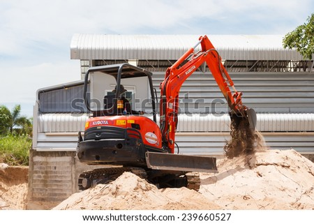 Rayong Thailand - Sep 9 2014: A worker driving excavator to placing sand for construction. - stock photo