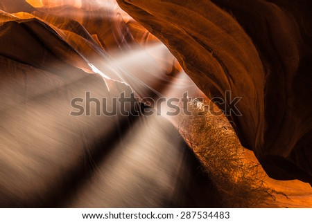 Rays of light enter deep cave.  - stock photo