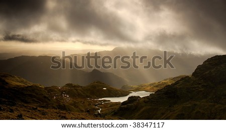 Rays of light over Stickle Tarn - stock photo