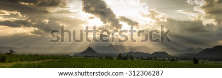 Rays of light shining through dark clouds . dramatic sky with cloud  - stock photo