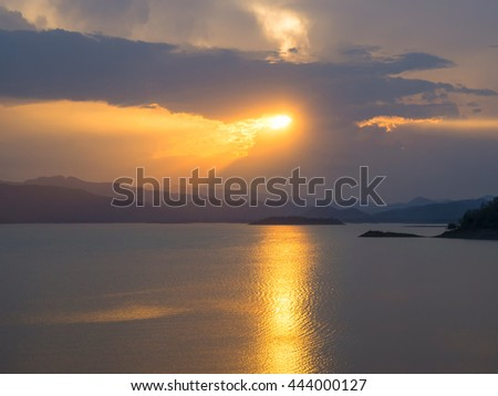 Rays of light shining through the clouds. - stock photo