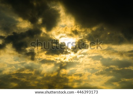 Rays of light shining through the storm  clouds. - stock photo