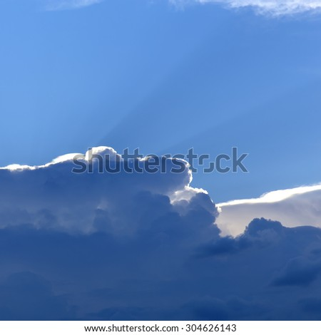 Rays of light shining up in the cloud. - stock photo