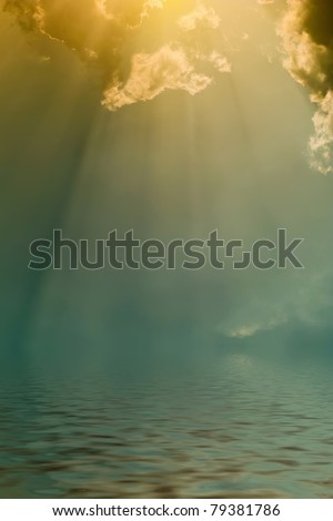 Rays of the sun through dark clouds over the water, the atmospheric background - stock photo