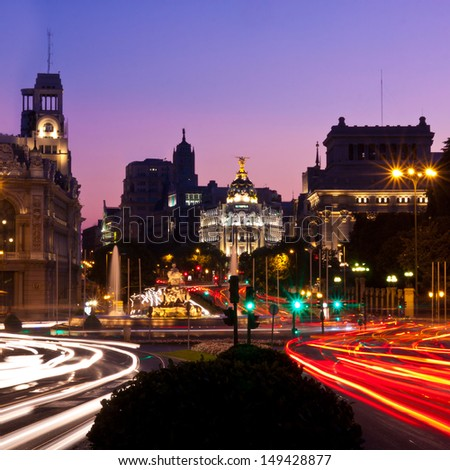 Rays of traffic lights on Calle de Alcala street in Madrid at night. Spain. - stock photo