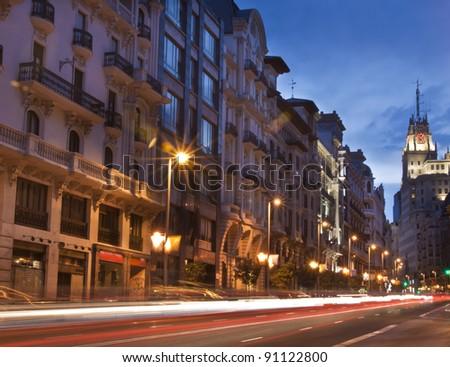 Rays of traffic lights on Gran via street, main shopping street in Madrid at night. Spain. - stock photo