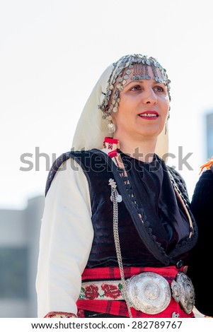 """RAZLOG, BULGARIA - APRIL 13, 2015: A beautiful female Bulgarian folklore dancer during the traditional folklore festival """"1000 national costumes"""" - stock photo"""